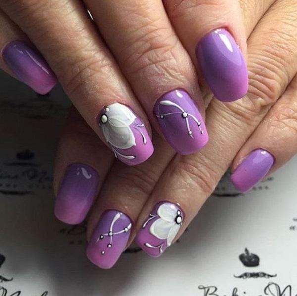 Gentle ombre with white motifs for the irresistible hands. - 45 Purple Nail Art Designs Art And Design