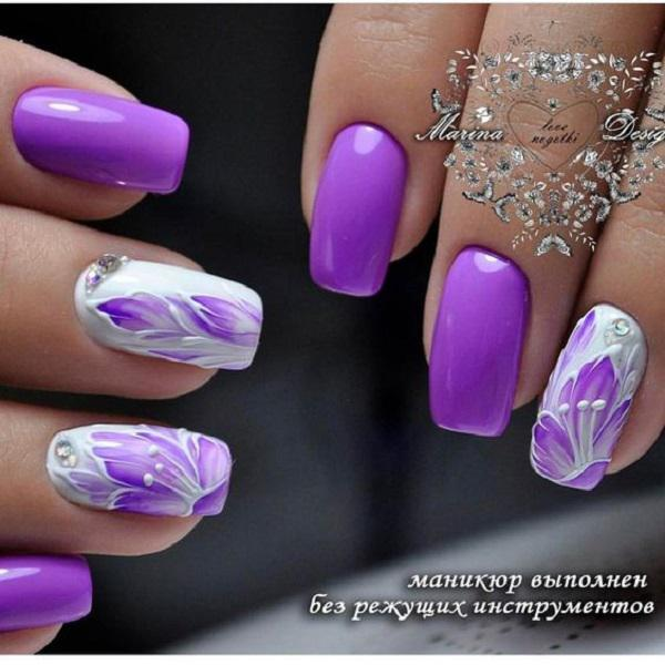 This spring, beautifully combined purple and white color will be a  delightful choice. - 45 Purple Nail Art Designs Art And Design