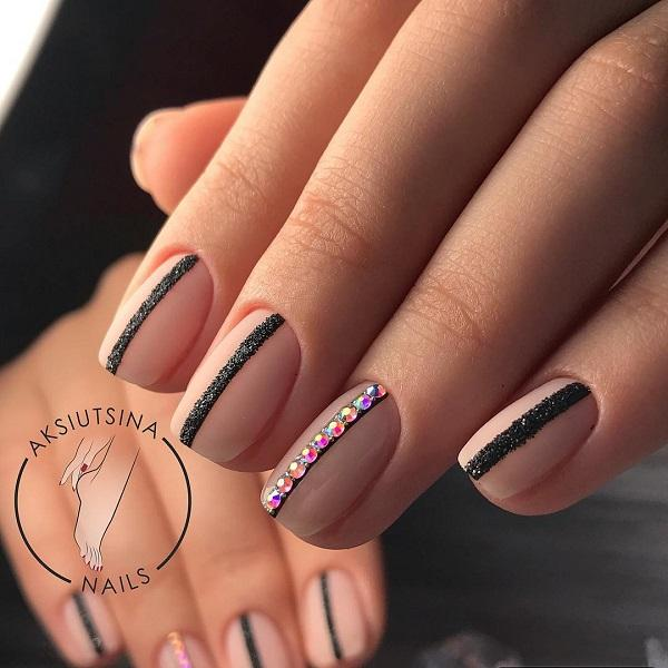 This delicate and exquisite design combines pink and simmering black. - 55 Stripes Nail Art Ideas Art And Design
