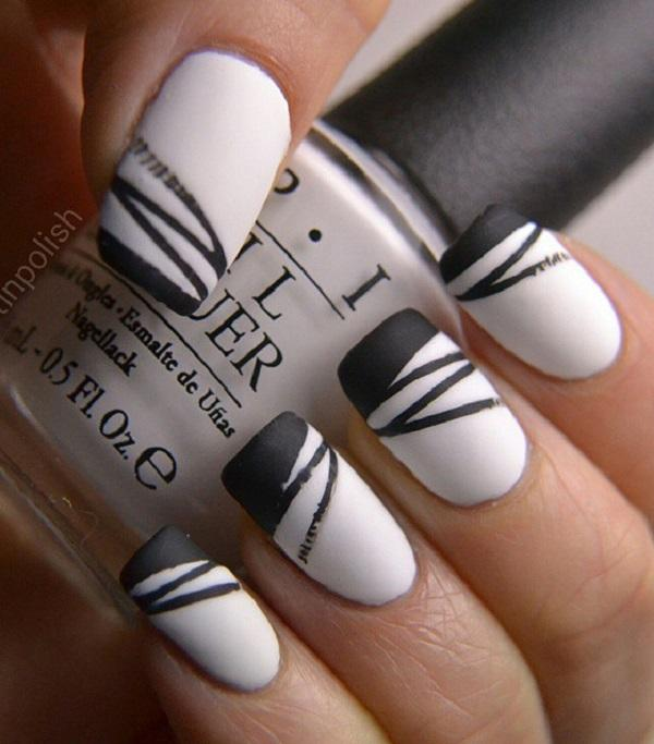 White nail color looks plain and boring. Make a fashion statement by adding  black stripes ... - 55 Stripes Nail Art Ideas Art And Design