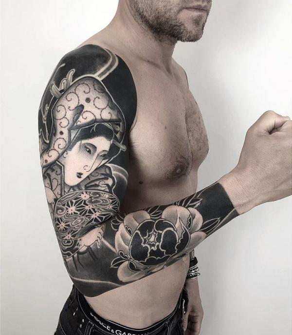 Japanese full sleeve tattoo in blackwork style 1