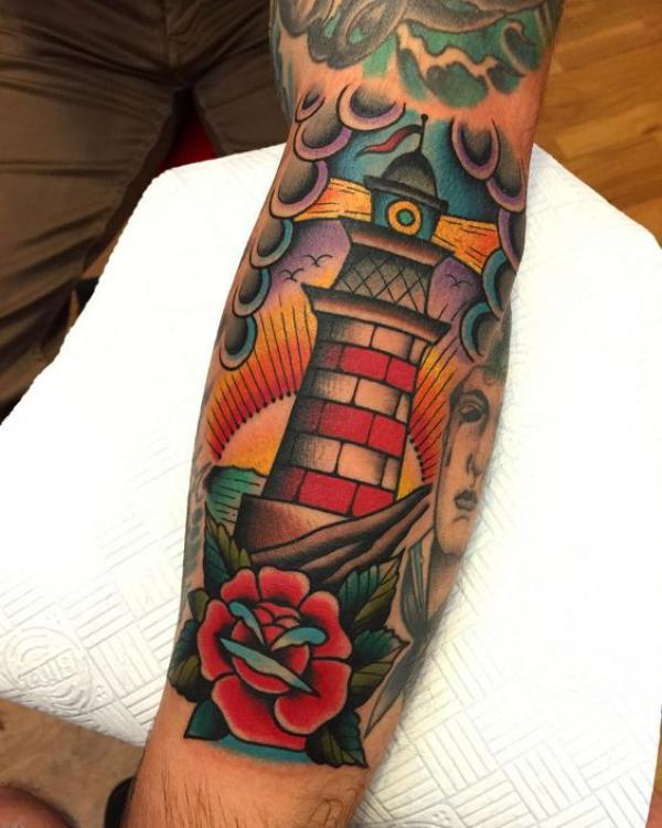 Lighthouse Old School tattoo on forearm