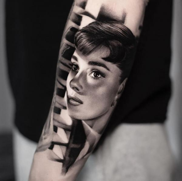 Realism celebrity portrait tattoo