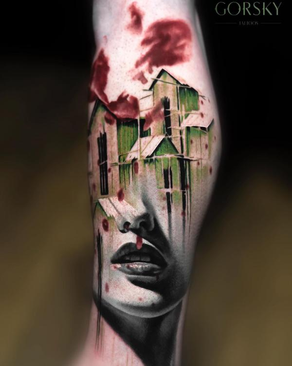 Surrealism tattoo on forearm